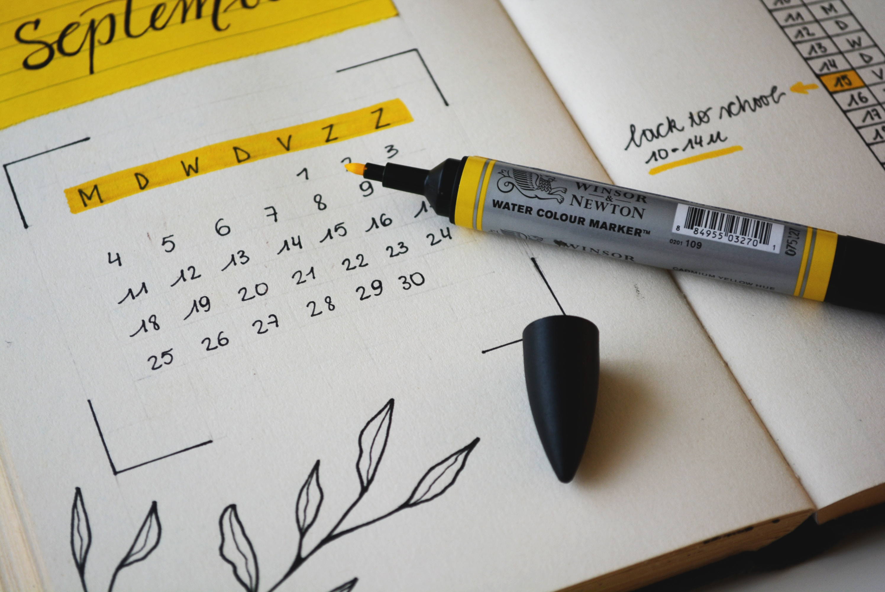Diary open at September with yellow pen