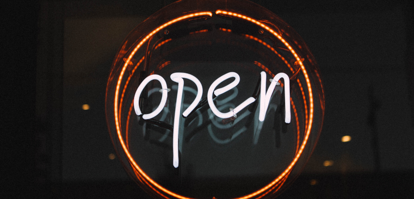 Illuminated open sign in orange ring